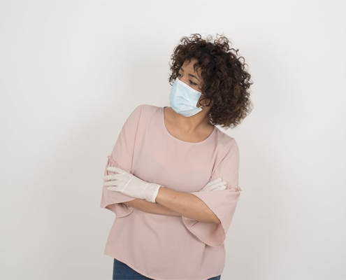 woman with mask and gloves looking to her right