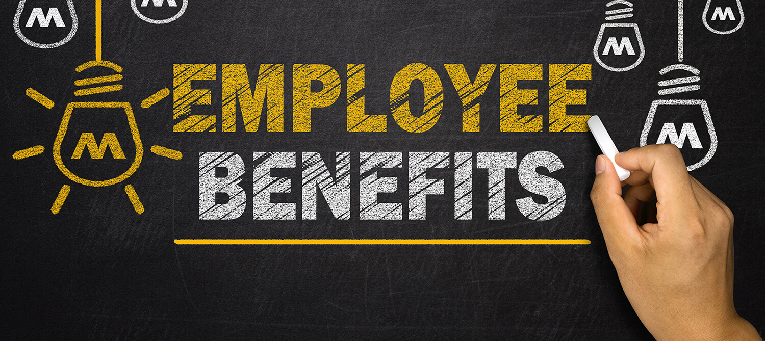 Employee Benefits written on a chalkboard in yellow and white