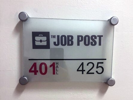 the job post staffing's new office sign at 401 hall st sw in grand rapids mi
